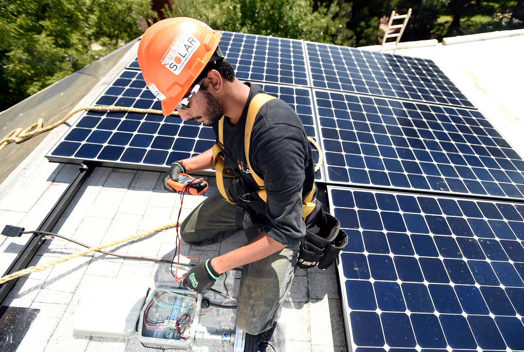 . Custom Solar Installation Lead works to finish installing solar panels on a roof on Thursday in Boulder. For more photos of the installation go to dailycamera.com Jeremy Papasso/ Staff Photographer/ Aug 10, 2017