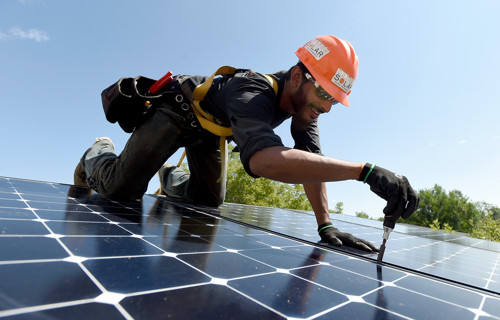 . Custom Solar Installation Lead Shravan Joshi works to finish installing solar panels on a roof on Thursday in Boulder. For more photos of the installation go to dailycamera.com Jeremy Papasso/ Staff Photographer/ Aug 10, 2017