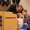 Tom O'Day helps two children form their thoughts into words before speaking at the Ryan O'Day Celebration of Life Ceremony on Wednesday @ Epping High School, Epping, NH on 4-15-2015.  Matt Parker Photos