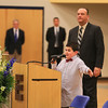 Tom O'Day listens to 4th Grader Adam Ennaciri as he tells the O'Day's and community how much he misses Ryan and how much Ryan meant to him at the Ryan O'Day Celebration of Life Ceremony on Wednesday @ Epping High School, Epping, NH on 4-15-2015.  Matt Parker Photos