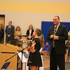 Tom O'Day smiles as a student tells a story of how Ryan has affected her life at the Ryan O'Day Celebration of Life Ceremony on Wednesday @ Epping High School, Epping, NH on 4-15-2015.  Matt Parker Photos
