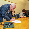 Chris Hildreth co-signs his daughter Alison's  letter of intent to play Field Hockey with the Penmen of Southern NH University in the Fall of 2016 at signing day on 4-13-2016 @ WHS.  Matt Parker Photos