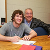 Winnacunnet Senior Mike Lewis with Father Mike sign letter of intent to play football with the Skyhawks of Stonehill College in the Fall of 2016 at signing day on Wednesday 4-13-2016 @ WHS.  Matt Parker Photos