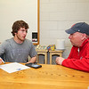 Winnacunnet Senior Mike Lewis talks with Hampton Union Sport Reporter Jay Pinsonnault about his plans for football at Stonehill College in the Fall of 2016 at signing day on Wednesday 4-13-2016 @ WHS.  Matt Parker Photos