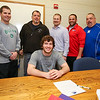 Winnacunnet Senior Mike Lewis poses for a photo with WHS Football Coaches (L to R) Larry Francoeur, Ron Auffant, Ryan Francoure, Pat Snow and Dennis Bruce.  Mike intends to play football with the Skyhawks of Stonehill College in the Fall of 2016 at signing day on Wednesday 4-13-2016 @ WHS.  Matt Parker Photos