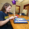 Winnacunnet Senior Alison Hildreth cuts the celebration cake at WHS signing day.  Alison signed a letter of intent to play Field Hockey with the Penmen of Southern NH University in the Fall of 2016 at signing day on 4-13-2016 @ WHS.  Matt Parker Photos