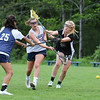 York's Mackenzie Mallett makes a underhand shot with #25 Jackie Tabora and Emlyn Patry defending during Monday's Girls Lacrosse practice on 5-30-2016 at York High School.  Matt Parker Photos
