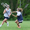 York's Mackenzie Mallett calls out a play as she cuts to the net with a defender stepping in to cover during Monday's Girls Lacrosse practice on 5-30-2016 at York High School.  Matt Parker Photos