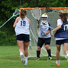 York's Mackenzie Mallett takes a shot during practice with York's Goal Keeper Juliana Kiklis, #17 Cara Smith and others defending during Monday's Girls Lacrosse practice on 5-30-2016 at York High School.  Matt Parker Photos
