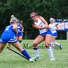 Winnacunnet's #7 Sam Crochetiere takes a swing at the ball and sends it into the air as Salem's #7 Alison Beauchesne defends at Friday's girls field hockey game between Winnacunnet and Salem High Schools on 9-6-2019 @ WHS.  [Matt Parker/Seacoastonline]