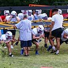 WHS coach Dennis Bruce (L) with coach Seth Provencher monitor form as the players run a drill using the linemans chute at Tuesday's Warriors Veer Football Camp on 8-13-2019 @ Winnacunnet High School.  [Matt Parker/Seacoastonline]