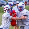 WHS junior Christian Fortin works to get around blocker sophmore Liam Considine at Tuesday's Warriors Veer Football Camp on 8-13-2019 @ Winnacunnet High School.  [Matt Parker/Seacoastonline]