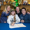 """Winnacunnet's Jenna Fiore poses with her Field Hockey coach Heidi Hand  (L) and Seacoast United Coaches Sarah Michaud and Melissa Nawn (R), Jenna signed a letter of intent to play Field Hockey with the Pioneers of Long Island University in the Fall of 2019, photo taken on Wednesday """"signing day"""" 3-13-2019 @ WHS.  [Matt Parker/Seacoastonline]"""