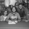"""Winnacunnet's Brennan Kittredge signs a letter of intent to play soccer for the Monks of Saint Joseph's College in Maine in the Fall of 2019 with his parents Amanda and Ned, photo taken on Wednesday """"signing day"""" 3-13-2019 @ WHS.  Matt Parker Photos"""