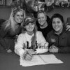 """Winnacunnet's Jenna Fiore poses with her Field Hockey coach Heidi Hand  (L) and Seacoast United Coaches Sarah Michaud and Melissa Nawn (R), Jenna signed a letter of intent to play Field Hockey with the Pioneers of Long Island University in the Fall of 2019, photo taken on Wednesday """"signing day"""" 3-13-2019 @ WHS.  Matt Parker Photos"""