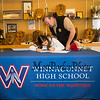 Craig Annis looks over his daughter Dailyn's shoulder as she signs a letter of intent to play field hockey in the Fall of 2019 for the Panthers of Adelphi University in Garden City, NY on signing day, Tuesday 4-30-2019 @ WHS.  Matt Parker Photos