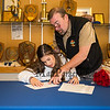 Craig Annis looks over his daughter Dailyn's shoulder and asks questions as she signs a letter of intent to play field hockey in the Fall of 2019 for the Panthers of Adelphi University in Garden City, NY on signing day, Tuesday 4-30-2019 @ WHS.  Matt Parker Photos