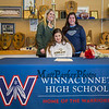 Winnacunnet Warriors Dailyn Annis with her field hockey coaches Winnacunnet coach Heidi Hand(L) and Seacoast United coach Melissa Nawn as she signs a letter of intent to play field hockey in the Fall of 2019 for the Panthers of Adelphi University in Garden City, NY on signing day, Tuesday 4-30-2019 @ WHS.  [Matt Parker/Seacoastonline]