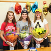 (L to R) Kelly Arsenault:  Sacred Heart University Pioneers, Fairfield, CT for Women's Cross Country,  Meg Dzialo:  Merrimack College Warriors, North Andover, MA for Women's Lacrosse,  Abby Merrill:  Appalachian State University Mountaineers, Boon, NC for Women's Field Hockey pose with flowers after signing letters of intent at their respective schools on Wednesday 11-9-2016 @ WHS.  Matt Parker Photos