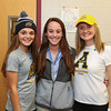 (L to R) Meg Dzialo, Mikaela Harding WHS Athletic Trainer and Abby Merrill pose for a photo at the WHS Fall siging day where the Seniors sign letters of intent to play at their respective schools on Wednesday 11-9-2016 @ WHS.  Matt Parker Photos