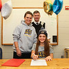 Meg Dzialo with parents Lindsay and Eric Beaulieu sign a letter of intent to play Women's Lacrosse in the Fall of 2017 for the Warriors of Merrimack College, North Andover, MA on Wednesday 11-9-2016 @ WHS.  Matt Parker Photos