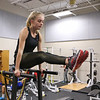Winnacunnet Junior Caitlin Capezzuto works on core exercises at the Winnacunnet Workout Room prior to Wednesday's bus trip to the scheduled team practice at UNH on 12-7-2016 @ WHS.  Matt Parker Photos