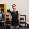 Winnacunnet Senior Phillip Antonio and Junior Billy Powers work on bicep curls at the Winnacunnet Workout Room prior to Wednesday's bus trip to the scheduled team practice at UNH on 12-7-2016 @ WHS.  Matt Parker Photos