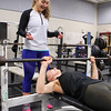 Winnacunnet Junior Caitlin Capezzuto is spotted by Junior Michaela Maloney while performing a bench press with the 45lb bat at the Winnacunnet Workout Room prior to Wednesday's bus trip to the scheduled team practice at UNH on 12-7-2016 @ WHS.  Matt Parker Photos