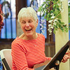 Libby Ellwood has some laughs with Janet Hugi while working on their chords with the Rockin' Ukulele Group instruction at the Seacoast Academy of Music on Tuesday at Centennial Hall, N. Hampton, NH on 4-19-2016.  Matt Parker Photos