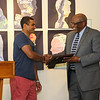 SAACC President Kelvin Edwards presents the 2016 Juanita Bell Memorial Scholarship to York High School's Stephen Reid at the Seacoast African American Cultural Center on Sunday 6-12-2016, Portsmouth, NH.  Matt Parker Photos