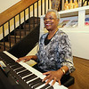 Royaline Edwards plays the keyboards at the 2016 Juanita Bell Memorial Scholarship recipient Stephen Reid of York High School at the Seacoast African American Cultural Center on Sunday 6-12-2016, Portsmouth, NH.  Matt Parker Photos