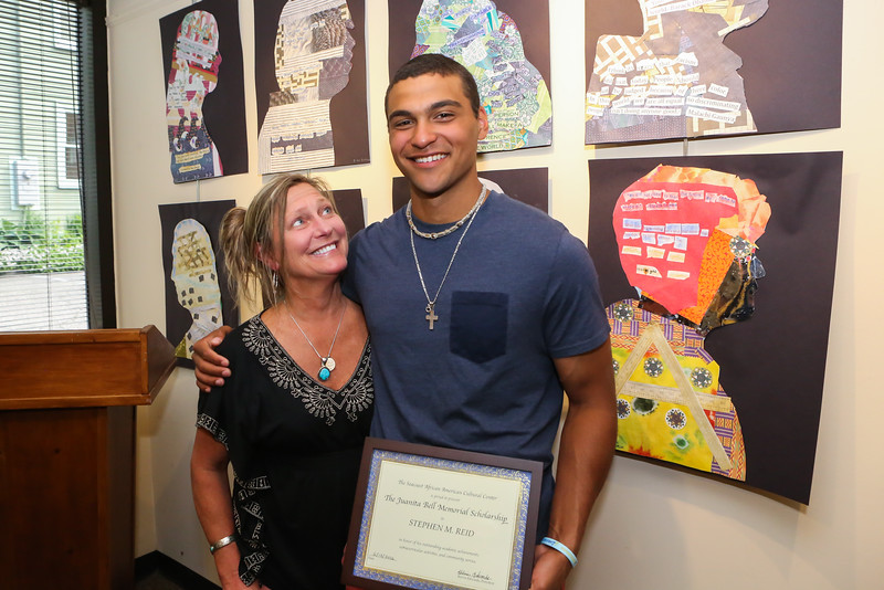 Paula Reid looks at her son Stephen at the 2016 Juanita Bell Memorial Scholarship recipient Stephen Reid of York High School at the Seacoast African American Cultural Center on Sunday 6-12-2016, Portsmouth, NH.  Matt Parker Photos