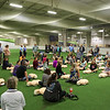 Students kneel next to Resuscitation Annie manikins during a CPR/AED training exercise at Saturday's free CPR/AED training class sponsored by Exeter Hospital at Seacoast United Soccer Club, Hampton, NH on 6-4-2016.  Matt Parker Photos