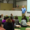 Dartmouth-Hitchcock Cardiologist Dr Jon Wahrenberger recounts his story about a 14 year old basketball player that collapsed on the court from complete cardiac failure and the people who brought him back during Saturday's free CPR/AED training class sponsored by Exeter Hospital at Seacoast United Soccer Club, Hampton, NH on 6-4-2016.  Matt Parker Photos
