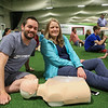 Brett and Karen Mahoney of Hampton with their Resuscitation Annie manikin at Saturday's free CPR/AED training class sponsored by Exeter Hospital at Seacoast United Soccer Club, Hampton, NH on 6-4-2016.  Matt Parker Photos