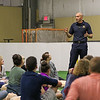 Craig Jordan of the Hampton Fire Department was a First Responder to a recent medical emergency where a 14 year old basketball player collapsed on the court from complete cardiac failure.  Craig spoke to the students about the importance of CPR/AED education and training at Saturday's free CPR/AED training class sponsored by Exeter Hospital at Seacoast United Soccer Club, Hampton, NH on 6-4-2016.  Matt Parker Photos