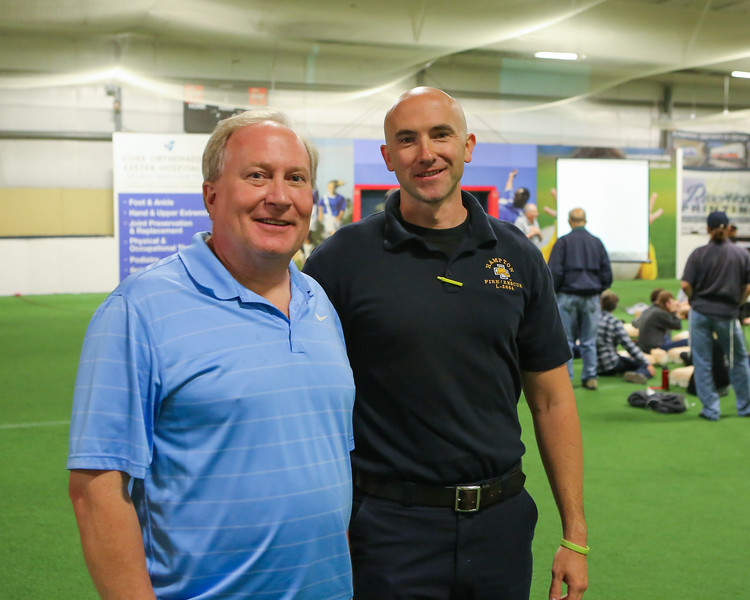 Dartmouth-Hitchcock Cardiologist Dr Jon Wahrenberger (L) and Craig Jordan of the Hampton Fire Department pose for a photo at Saturday's free CPR/AED training class sponsored by Exeter Hospital at Seacoast United Soccer Club, Hampton, NH on 6-4-2016.  Matt Parker Photos