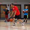 Winnacunnet Boys Basketball Coach Jay McKenna demonstrates a dribbling drill to his players on Tuesday at the Winnacunnet Warrior Summer Hoop Camp on 7-12-2016 @ WHS. Matt Parker Photos
