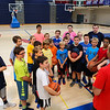 Winnacunnet Boys Basketball Coach Jay McKenna gives instructions to his players with assitents (L to R back row) 9th grader James Adams, Sophomore Marisa Lamprey and Senior Michael Lamprey on Tuesday at the Winnacunnet Warrior Summer Hoop Camp on 7-12-2016 @ WHS. Matt Parker Photos