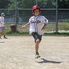 4th grader Hayden Schimoler hustles to 1st after getting a hit during the 26th Annual Bruce Joyce's Granite State Baseball School on Tuesday 7-26-2016 at Exeter High School.  Matt Parker Photos