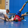 Winnacunnet Wrestling Coach Eric Larcomb gives instruction to 9th grader Gage Bolduc as he puts 12th grader Matt Cooney (red) into a hold during the Riptide Wrestling Youth Camp at WHS on Tuesday 7-26-2016.  Matt Parker Photos