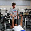 Winnacunnet's Bryce Libbey spots Liam Viviano on the bench press during a preseason workout at the Winnacunnet Gym on Wednesday 7-6-2016 @ WHS.  Matt Parker Photos