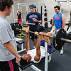Winnacunnet's Liam Viviano works out on the bench press with Billy Powers and Andrew Mills watching with Bryce Libbey spotting the bar during a preseason workout at the Winnacunnet Gym on Wednesday 7-6-2016 @ WHS.  Matt Parker Photos
