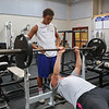 Winnacunnet's Bryce Libbey is spotted by Liam Viviano on the bench press during a preseason workout at the Winnacunnet Gym on Wednesday 7-6-2016 @ WHS.  Matt Parker Photos