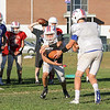 Winnacunnet QB Patrick MacDougall hands the ball off to Junior Billy Powers during a running play at Tuesday's Football Practice on 8-23-2016 at WHS.  Matt Parker Photos