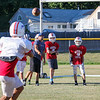 Winnacunnet Assistant Coach Jake Goldstein throws to Senior Liam Viviano during Tuesday's Football Practice on 8-23-2016 at WHS.  Matt Parker Photos
