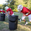 Winnacunnet Freshman Timmy Sicard with fellow teammates work on a line drill during Tuesday's Football Practice on 8-23-2016 at WHS.  Matt Parker Photos