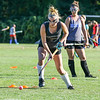 Winnacunnet's Senior Field Hockey Captain Abby Merrill works the ball around cones with her stick during Tuesday's Practice on 8-23-2016 at WHS.  Matt Parker Photos