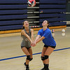 Winnacunnet Juniors Rori Reed (L) and Katelyn Deyo work to set the ball during Monday's Girls Volleyball practice on 8-29-2016 @ WHS.  Matt Parker Photos