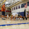 Winnacunnet Girls Volleyball Assistant Coach George Sullivan keeps the drill moving with Sophia Stefanov (yellow headband) does push-ups during Monday's practice on 8-29-2016 @ WHS.  Matt Parker Photos